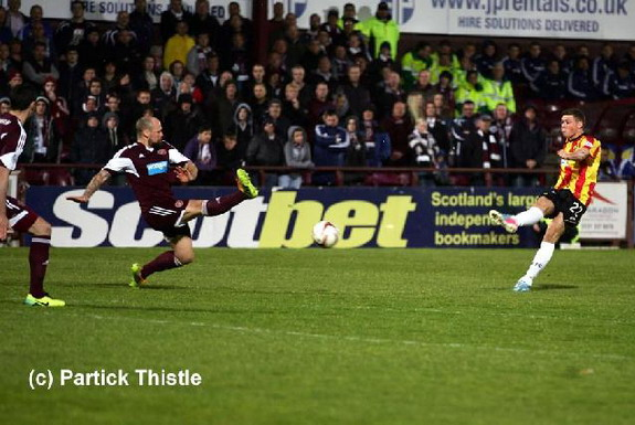 Partick Thistle player Gary Fraser shoots to score his side's second goal against Hearts
