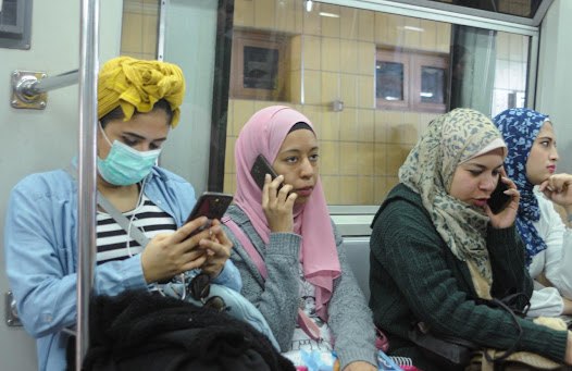"""Egyptian women and girls in the metro in time of coronavirus """"AFP"""""""