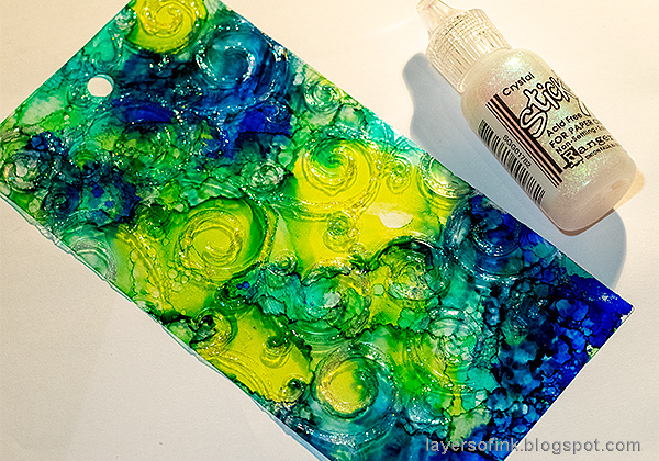 Layers of ink - Recycled Tag Tutorial by Anna-Karin Evaldsson. Adding Stickles glitter glue.