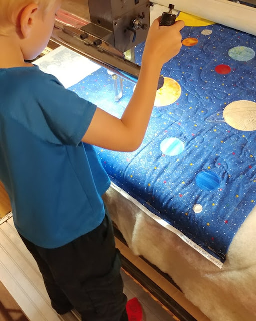 Six year old boy longarm quilting