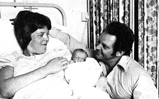 Image: Louise with her parents Lesley and John following her birth at Oldham General Hospital Photo: PA
