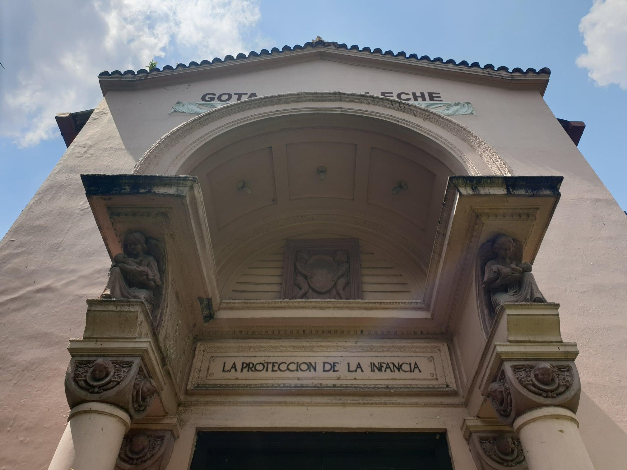 La Gota de Leche building statuary of a woman holding an infant inscribed La Proteccion de La Infancia