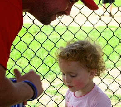 Dad talking with daughter about having  a Baseball Opening Day Holiday and Inside Baseball
