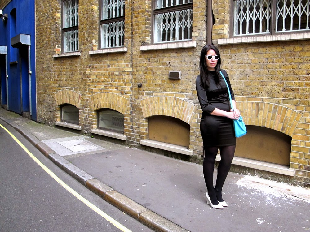 London fashion blogger Emma Louise Layla in black satin Topshop dress
