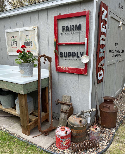 Photo of garden shed with farm junk decor