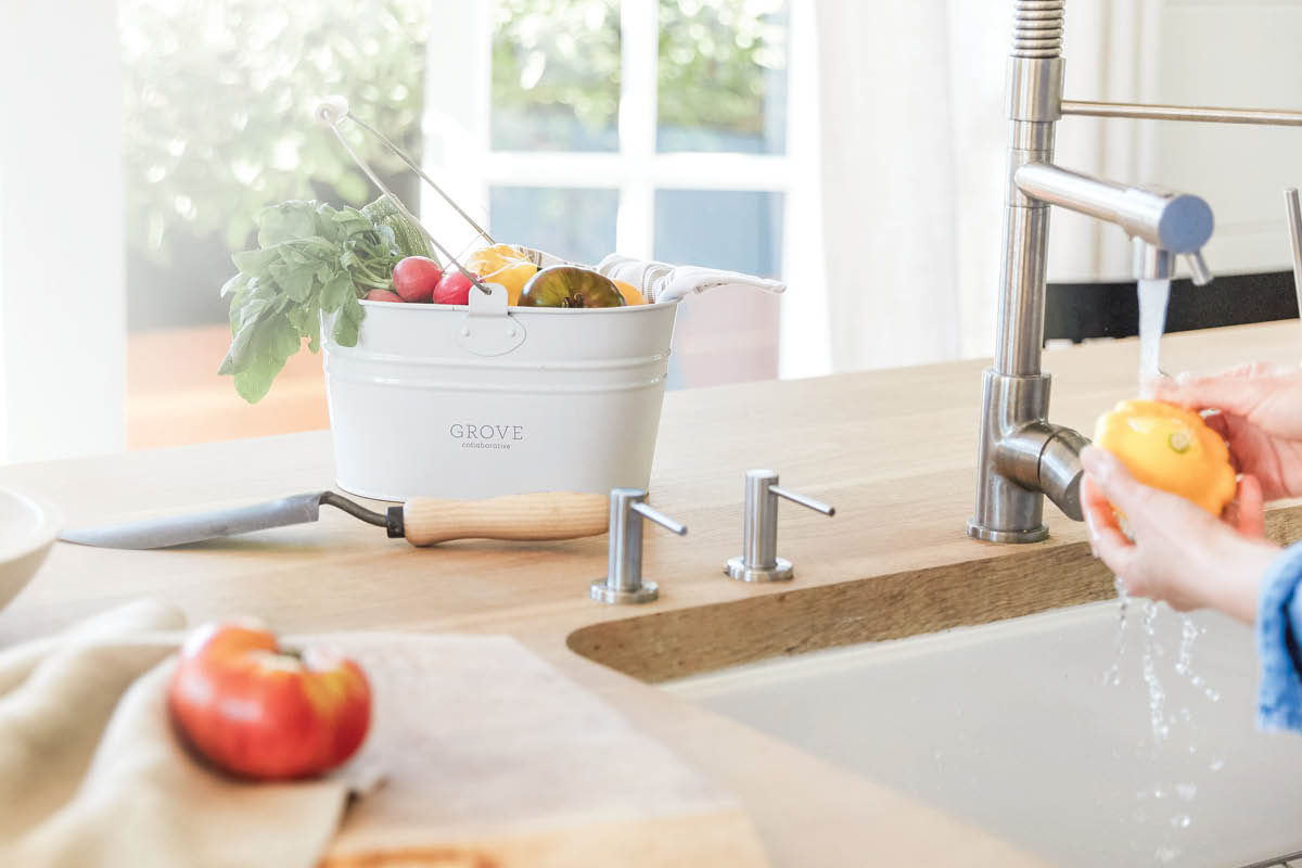white enamel caddy with vegetables