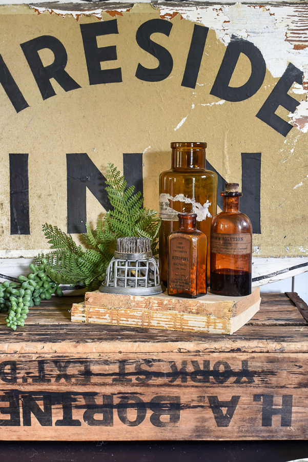 Styled vintage amber apothecary bottles