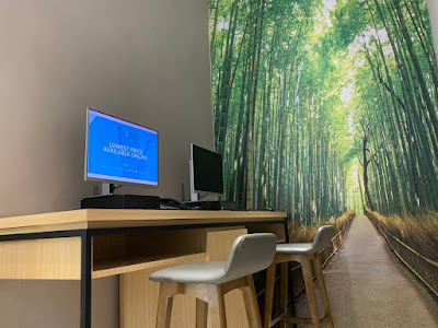 Business corner with computers, against backdrop of Arashiyama Bamboo Forest in Kyoto, Japan