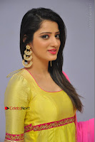 Actress Richa Panai Latest Pos in Yellow Anarkal Dress at Rakshaka Bhatudu Telugu Movie Audio Launch Event  0003.JPG