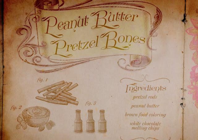huesos de  pretzel con mantequeilla de cacahuete, tiene asepcto de receta de libro de brujas o pergamino con dibujos que van acompañados de fig. 1  y lista de ingredientes