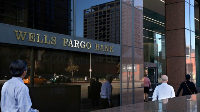 Wells Fargo shares hammered by investors after unprecedented punishment by Federal Reserve