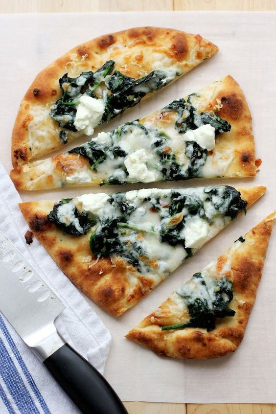 An quick, tasty flatbread pizza with garlicky spinach and tangy goat cheese. Perfect for an easy meal - just add a mixed green salad and a glass of wine and dinner is served.