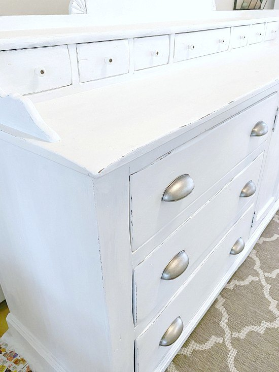White sideboard with pewter cup pulls.