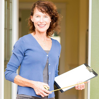 A picture of the blog's author, Mary Carol Peterson, holding a clipboard an pencil, smiling for the camera.