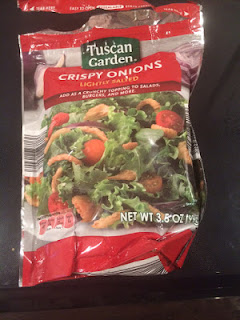 An open bag of Tuscan Garden Lightly Salted Crispy Onions, from Aldi