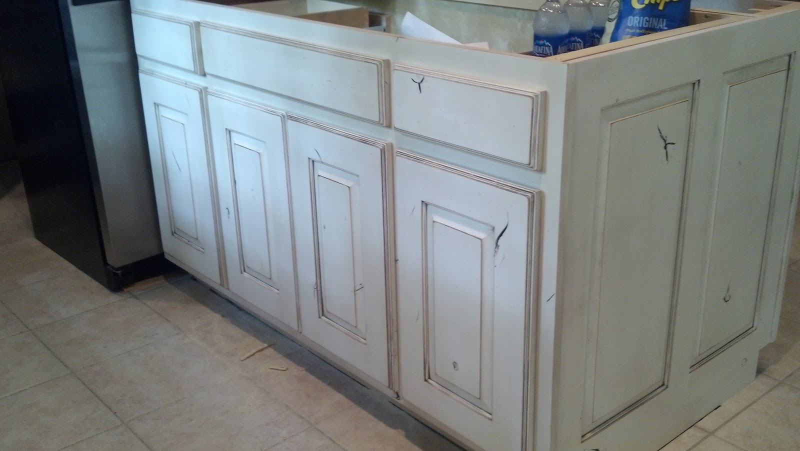Adkissons Cabinets White Painted and Distressed Knotty
