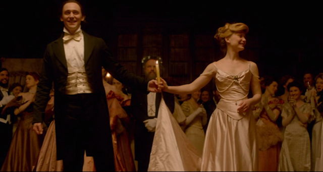 Thomas Sharpe (Tom Hiddleston) and Edith Cushing (Mia Wasikowska) finish the waltz in CRIMSON PEAK (2015).