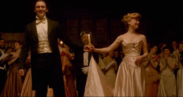 Thomas Sharpe (Tom Hiddleston) and Edith Cushing (Mia Wasikowska) finish the waltz in CRIMSON PEAK (2015).
