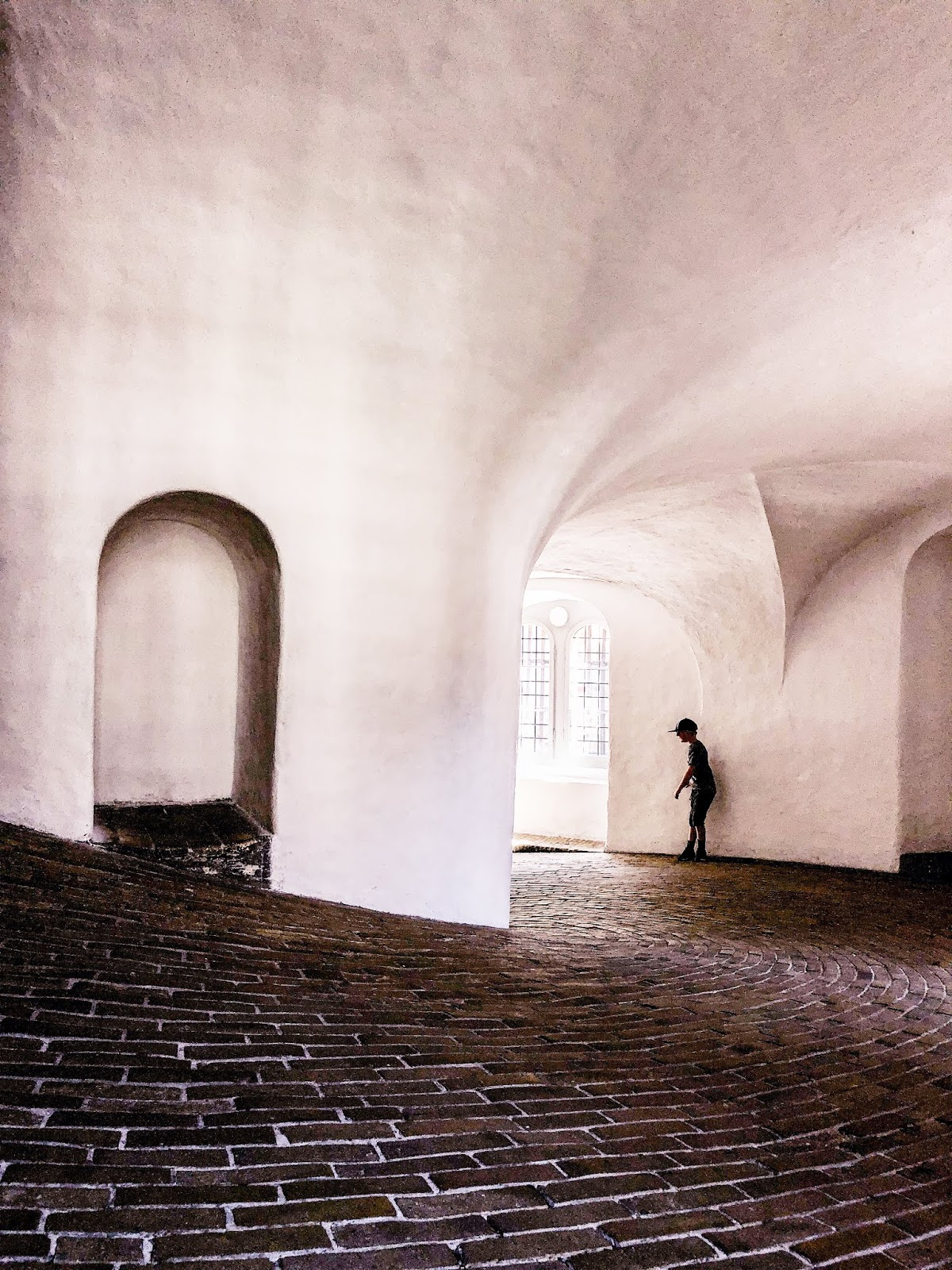sloped brick floor with white washed walls interior of Copenhagen's round tower