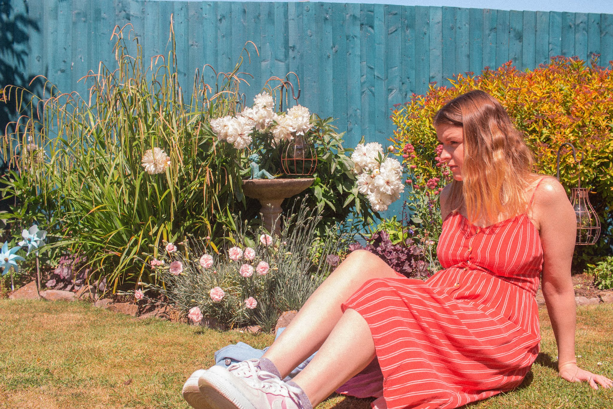 girl wearing red dress in flower garden - fashion blogger tips to enjoy instagram again