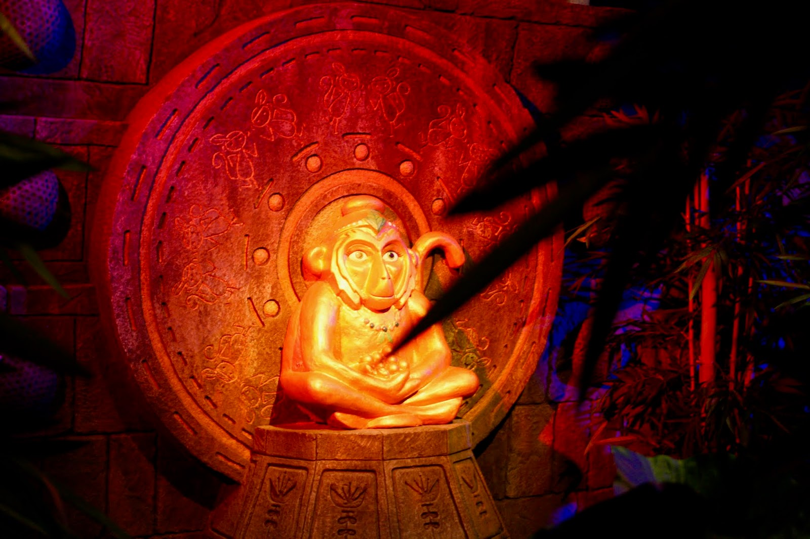 Mabel the Monkey Queen lit up in red lights along the Treetop Adventure Golf course