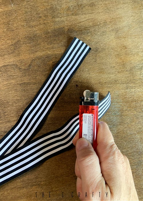 Singe ends of ribbon with lighter to keep from fraying.