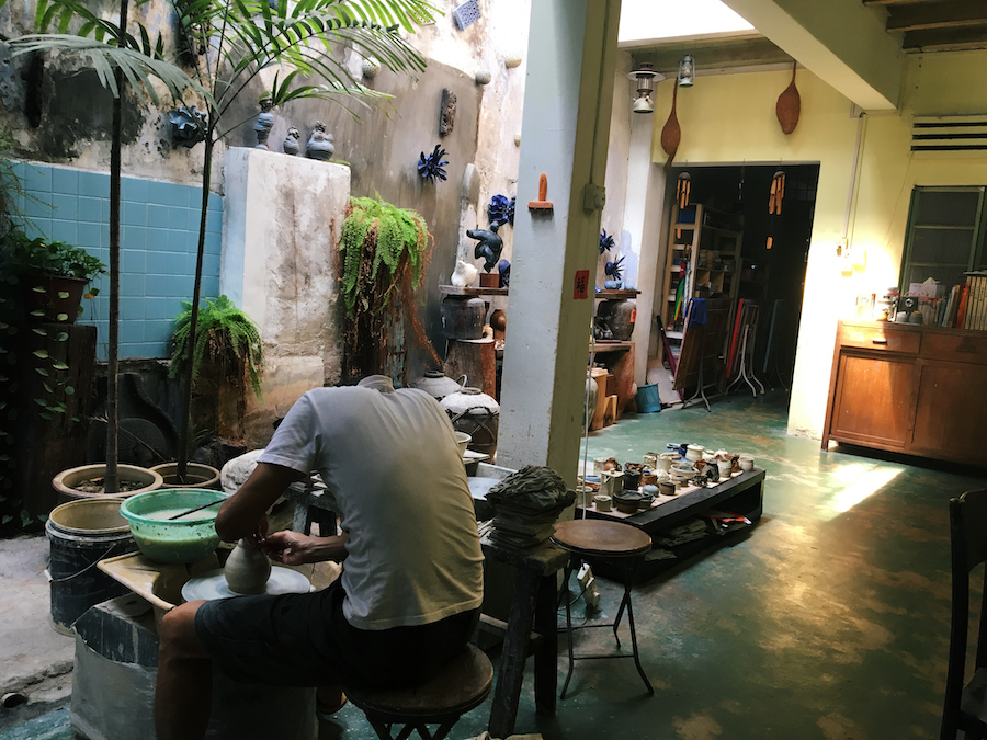 A potter at work in his store in Malacca Malaysia