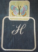 2 examples of frames.  small frame has inset embroidery, large frame has an a single letter H that is not centered