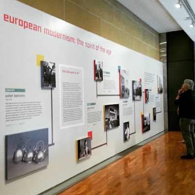 Man reading the introductory display on European modernism: the spirit of the age at The Moderns exhibition.