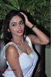 Actress Model Pooja Sri Stills in White Short Dress at F Club pre soft Launch  0215.JPG