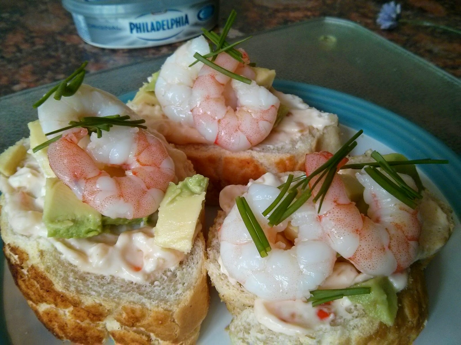 Baguette slices topped with Cream Cheese/Sweet Chill mix, Avocado and Prawns.