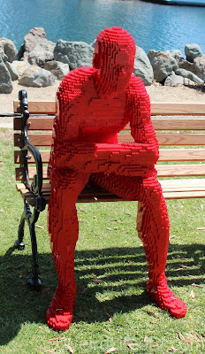 This red Lego man is deep in thought