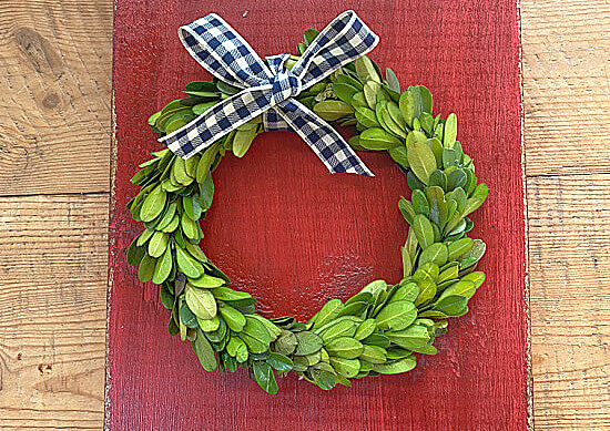 boxwood wreath with a gingham bow
