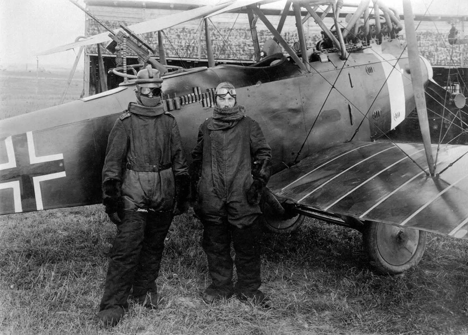 German pilot Richard Scholl and his co-pilot Lieutenant Anderer, in flight gear beside their Hannover CL.II biplane in 1918.