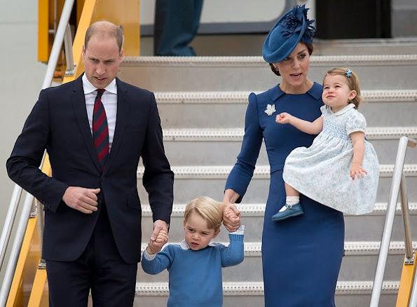 Duchess Catherine wore a bespoke blue dress by designer Jenny Packham. Gianvito Rossi 105 Suede Pumps. L.K. Bennett Nina Clutch.