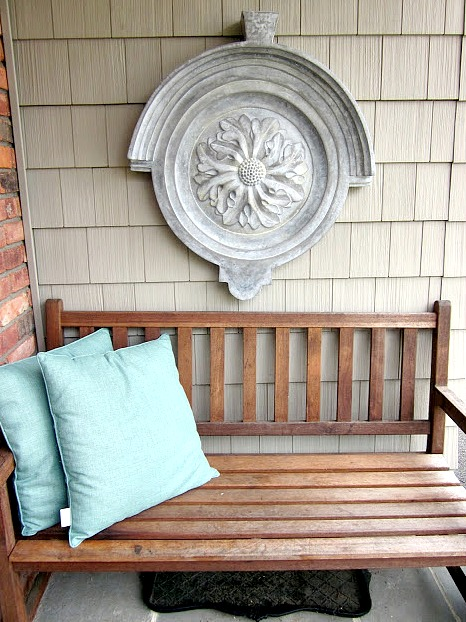 Outdoor wall hanging , teak bench and pillows