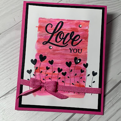 Valentine flowers with Love You sentiment on a Valentine Card