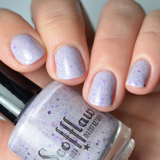 purple nail polish with purple holographic glitter