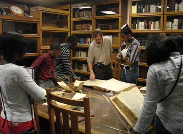 School Without Walls Law Camp studying 19th-century Monroe County maps in the Rare Book Room
