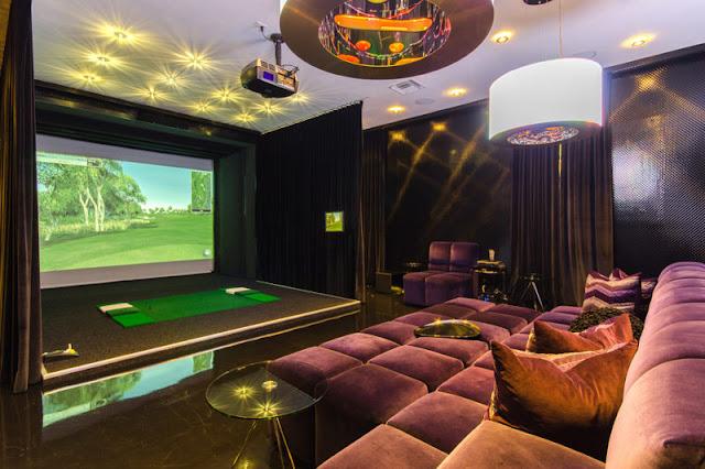 Celine Dion's Florida mansion purple velvet sectional in media room
