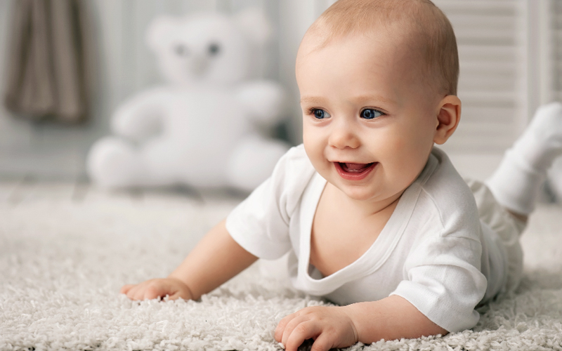 baby crawling on comfortable flooring