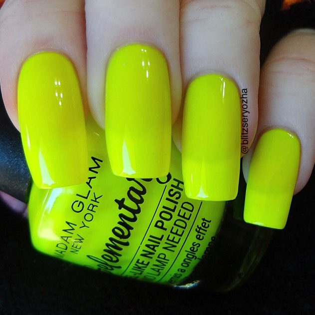 "A swatch photo showing three coats of Madam Glam ""Cheerleading Squad,"" a neon yellow creme polish"