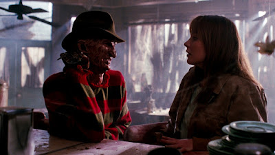 Robert Englund plays Freddy Kruger for the fourth time in a movie scene at a restaurant in Nightmare on Elm Street: The Dream Master