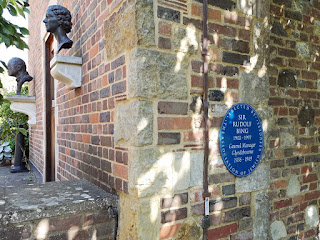 Sir Rudolf Bing blue plaque at Glyndebourne with busts of George Christie and Audrey Mildmay