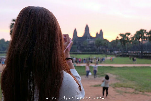 taking sunrise picture at angkor wat