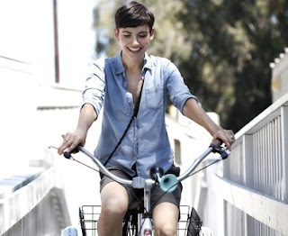 Gabriela Oltean riding a bicycle