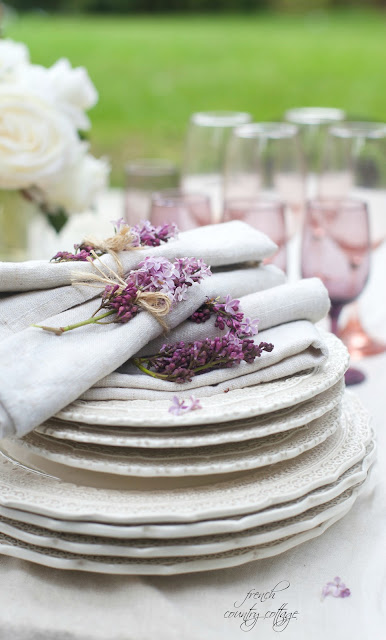 pastel colored glasses, lilacs and dishes