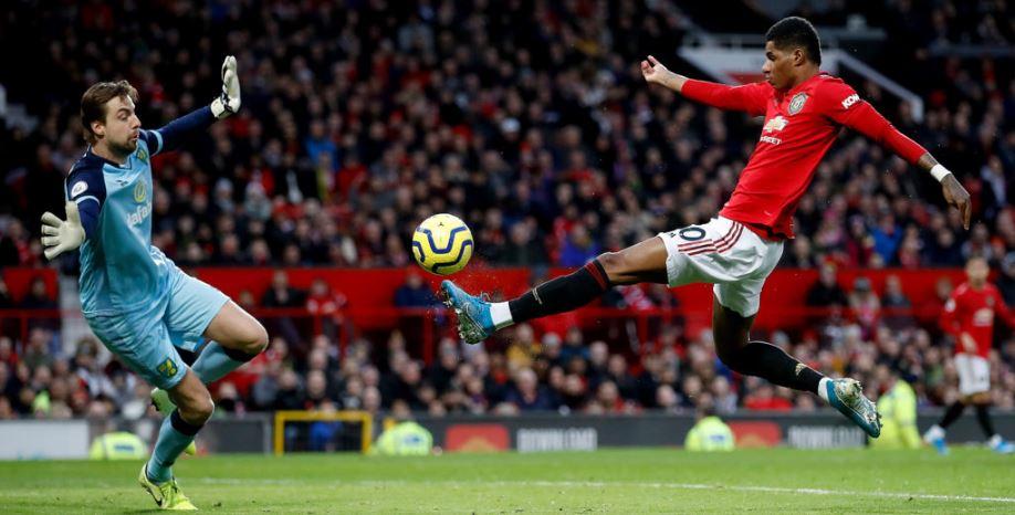 Marcus Rashford scores against Norwich City's Tim Krul