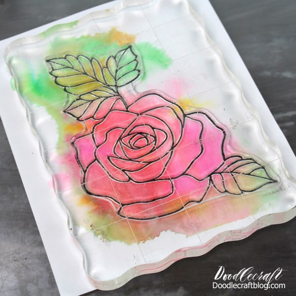 Use a rubber stamp or draw an image on a watercolor wash card.