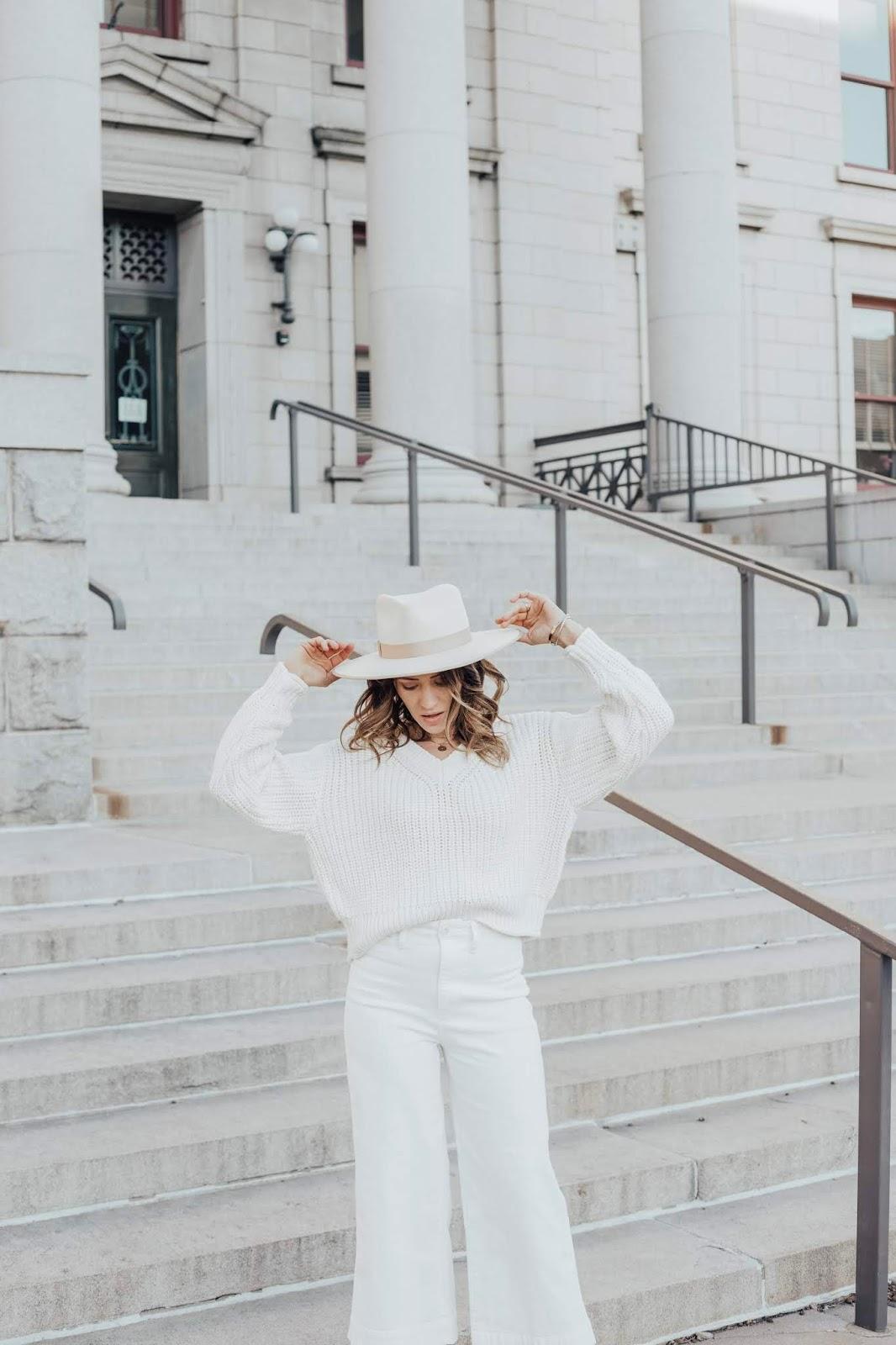 white sweater white jeans white hat